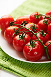 Fresh cherry tomatoes on the vine Stock Image