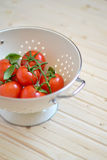 Fresh cherry tomatoes in a vintage colander Royalty Free Stock Photo