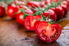 Fresh cherry tomatoes washed clean water. Cut fresh tomatoes Stock Images