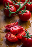Fresh cherry tomatoes washed clean water. Cut fresh tomatoes Royalty Free Stock Images