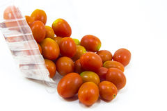Fresh cherry tomatoes  on white background. With box Stock Photos