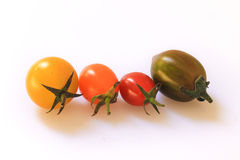 Fresh cherry tomatoes on white background. Stock Images