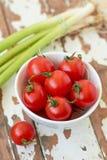 Fresh cherry tomatoes. In a white bowl Royalty Free Stock Photos