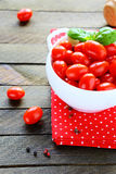 Fresh cherry tomatoes in a white bowl Stock Images