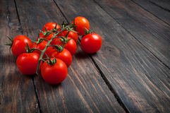 Fresh cherry tomatoes on wood background Royalty Free Stock Photos