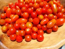 Fresh cherry tomatoes in a wooden bowl Royalty Free Stock Image