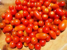 Fresh cherry tomatoes in a wooden bowl Stock Images