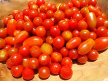 Fresh cherry tomatoes in a wooden bowl Stock Photos