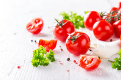 Fresh cherry tomatoes on a wooden table. Close-up Royalty Free Stock Image