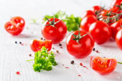 Fresh cherry tomatoes on a wooden table. Close-up Royalty Free Stock Photo
