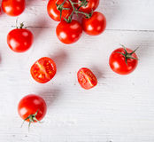 Fresh cherry tomatoes on a wooden table. Close-up Stock Photos