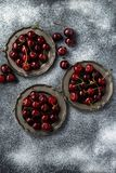 Fresh cherry in vintage silver plate over powdered sugarbackgro Stock Photography