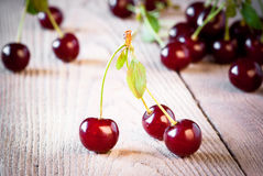 Fresh cherry on wooden table. Stock Images