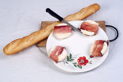 Fresh chese and baguette on display Royalty Free Stock Photos