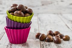 Fresh Chestnuts in Colorful Cups Royalty Free Stock Photography