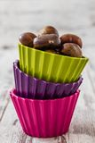 Fresh Chestnuts in Colorful Cups Stock Photo