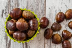 Fresh Chestnuts in Colorful Cups Stock Photos