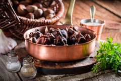 Fresh chestnuts with garlic sauce Stock Photo
