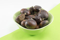 Fresh chestnuts in a green bowl Stock Photography