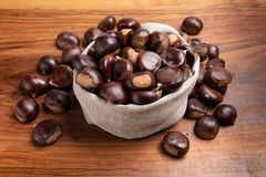Fresh chestnuts in linen sack royalty free stock images