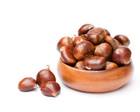 Fresh  chestnuts in wooden bowl on  white background Stock Photo