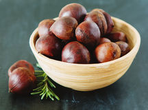 Fresh chestnuts in yellow bowl Royalty Free Stock Images