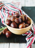 Fresh chestnuts in yellow bowl Royalty Free Stock Image