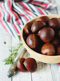 Fresh chestnuts in yellow bowl Stock Photo