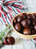 Fresh chestnuts in yellow bowl Royalty Free Stock Photography