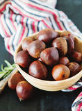 Fresh chestnuts in yellow bowl Stock Photography