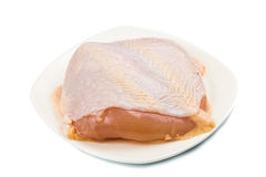 Fresh chicken breast meat with skin on plate Royalty Free Stock Image