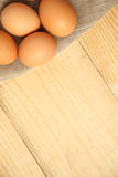 Fresh chicken brown eggs on linen napkin at rustic wood table. Raw organic brown eggs with copy space Royalty Free Stock Images