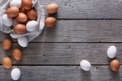 Fresh chicken brown eggs on linen, organic farming background Stock Photography