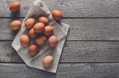 Fresh chicken brown eggs on linen, organic farming background Royalty Free Stock Image