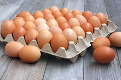Fresh chicken brown eggs in packing Royalty Free Stock Photos