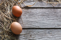 Fresh chicken brown eggs on rustic wood, organic farming concept background Stock Photo