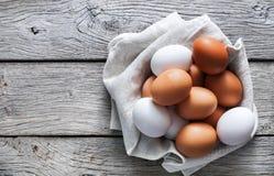 Fresh chicken brown eggs on rustic wood, organic farming concept Stock Photos