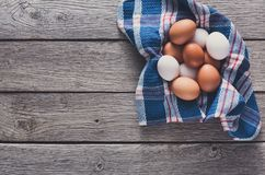 Fresh chicken brown eggs on rustic wood, organic farming concept royalty free stock images
