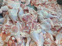 Fresh chicken on display in a meat market counter Stock Images
