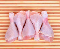 Fresh chicken drumsticks on cutting board Royalty Free Stock Image