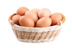Fresh Chicken eggs in basket isolated on white, close up stock photos