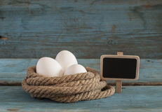 Fresh chicken eggs lay on the wooden table Stock Photo