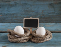 Fresh chicken eggs lay on the wooden table Royalty Free Stock Image