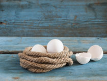 Fresh chicken eggs lay on the wooden table Royalty Free Stock Images
