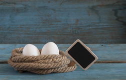 Fresh chicken eggs lay on the wooden table Stock Image
