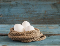 Fresh chicken eggs lay on the wooden table Stock Photos