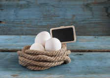 Fresh chicken eggs lay on the wooden table Royalty Free Stock Photo