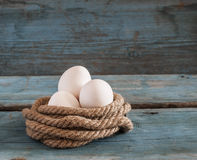 Fresh chicken eggs lay on the wooden table Royalty Free Stock Photography