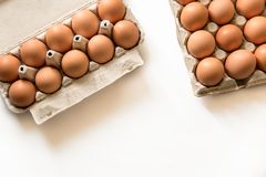 123/5000 Fresh chicken eggs on a white background. Fresh chicken eggs in the wrapping several eggs laid on a white background Stock Photography