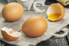 Fresh chicken eggs on wooden table. In backgrounds Royalty Free Stock Photos
